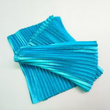 Blue pleated fabric. On white background Stock Image