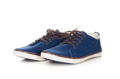 Blue plimsolls Stock Photos