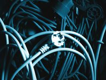 Blue plug. Rolls of electric cables with plugs in blue color Royalty Free Stock Image