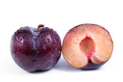 Blue plum and a half of a plum Royalty Free Stock Photography