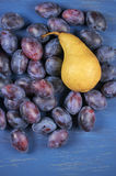 Blue plums and pear Stock Photos