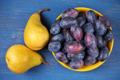 Blue plums and pears Royalty Free Stock Image