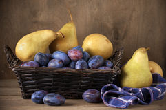 Blue plums and pears Royalty Free Stock Photo