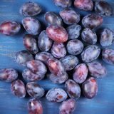 Blue plums on wood Royalty Free Stock Images