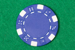 Blue poker chip on the casino table Royalty Free Stock Photography