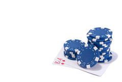 Blue poker chips and cards. Blue poker chips and poker ace and king cards isolated white Royalty Free Stock Image