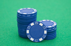 Blue poker chips on casino table Royalty Free Stock Photos