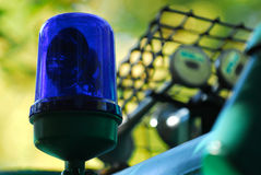 Blue police light 2. A police light at a big police car Royalty Free Stock Photo
