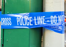 Blue police line. Plastic blue police line with do not cross sign Royalty Free Stock Images