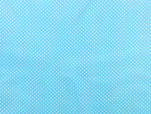 Blue polka dot background Stock Images