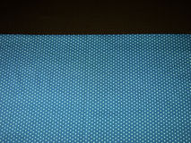 Blue polka dot and brown background Royalty Free Stock Photography