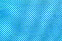 Blue polka-dot cotton table cloth.  Stock Photos
