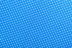 Blue polka-dot cotton table cloth directly above.  Royalty Free Stock Photography