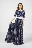 Blue polka dot dress on brunette woman Stock Photos