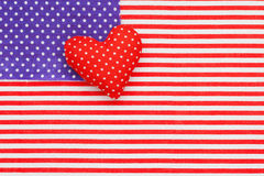 Blue polka dots and Red/white Striped Fabric as American flag Stock Photos
