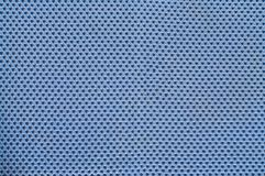 Blue Polyester breathable material texture with holes Closeup.  Stock Images