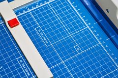 Blue polygraphic cutter with marking. Blue polygraphic cutter with macros Royalty Free Stock Images