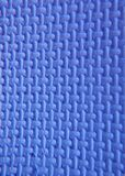 Blue polystyrene foam. A sheet of textured blue polystyrene foam background Royalty Free Stock Images