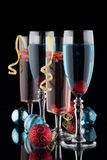 Blue and Pomegranate Champagne Cocktails Royalty Free Stock Photo