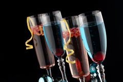Blue and Pomegranate Champagne Cocktails Royalty Free Stock Images