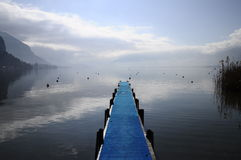 Blue pontoon on annecy lake Royalty Free Stock Images
