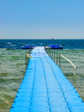 Blue pontoon on sea. Stock Images