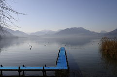Blue pontoon and view of annecy lake Royalty Free Stock Photo
