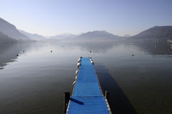 Blue pontoon and view of annecy lake Royalty Free Stock Photography