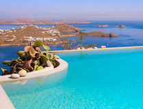 Blue Pool on a background of sky and sea on Mykonos in Greece. Royalty Free Stock Photos