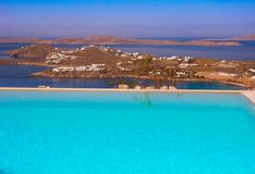 Blue Pool on a background of sky and sea on Mykonos in Greece. Stock Photography