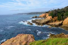 The Blue Pool, Bermagui. Bermagui`s famous Blue Pool is a `must see` Sapphire Coast attraction. It is located off Pacific Drive at the base of a dramatic rocky stock image