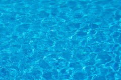 Blue pool water with sun reflections. Stock Photography