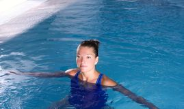 Blue pool woman beautiful swimming in water Stock Photography