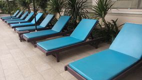 Blue poolside loungers Stock Photo
