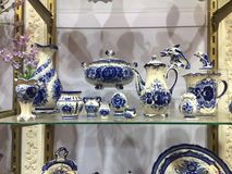 Blue Porcelain crockery for sale. Selection of plates, bowls and porcelain for sale in the shop. blue porcelain utensils with royalty free stock image