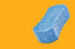 Blue porous blue sponge on yellow background with copy space royalty free illustration