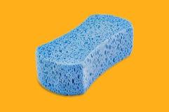 Blue porous blue sponge in center on yellow vector illustration