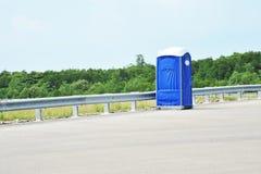 Blue Portable Toilet. Portable Toilet At The Road Shoulder Stock Photo