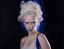 A blue portrait. Secret a very beautiful model with extrime blue makeup Stock Photo