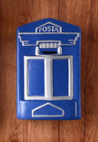 Blue Post box on wall Royalty Free Stock Photos