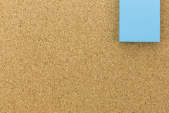 Blue post it on cork board Royalty Free Stock Image