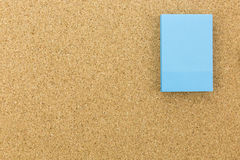 Blue post it on cork board Stock Photo