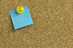 Blue post-it on corkboard Stock Photos