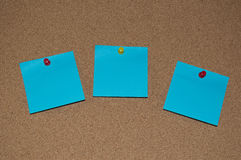 Blue Post it Notes on a Cork Board Stock Images