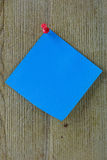 Blue Post It on Wood Royalty Free Stock Photos