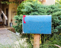 Blue postbox Royalty Free Stock Photo