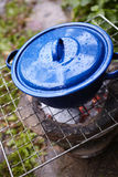 Blue pot on fire Stock Image