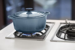 BLUE POT ON A GAS STOVE royalty free stock photo