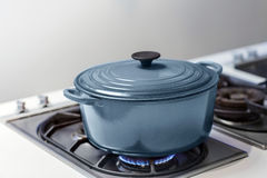 BLUE POT ON A GAS STOVE Stock Image