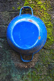 Blue Pot on the mossy wall Royalty Free Stock Photos